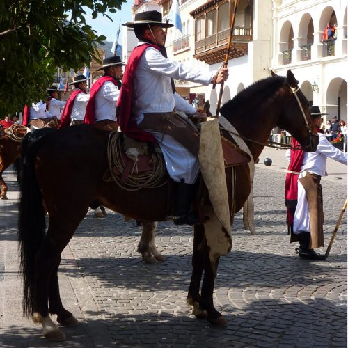 Gauchos parading on horses